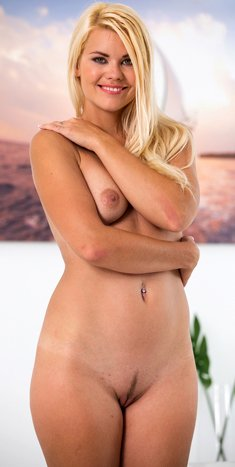 Beautiful sexy blonde Izzy Delphine inserts big dildo