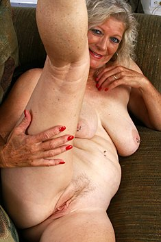 Busty granny with a piercing in the nipples