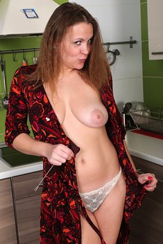 Busty Milf Afeena shows hairy pussy in the kitchen