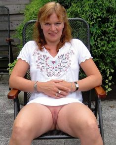 Redhead MILF shows nice shaved pussy