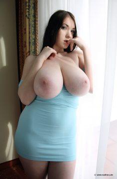 Busty brunette in blue dress