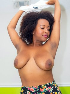 Busty ebony Whitney Williams shows off her big nipples and saggy breasts