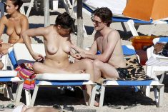 Daisy Lowe topless on the beach in Ibiza
