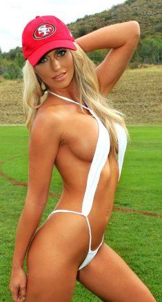 Elle Johnson flaunting her body in a white slingshot bikini