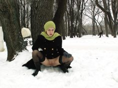 Naughty girl flashing and pissing on the snow