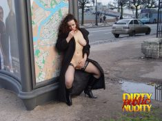 She is stipping on public and remeains in her black stockings