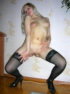 Dancing blonde in stockings and high heels.