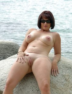 Busty MILF with shaved pussy