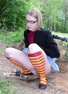Nerdy blonde teen pissing outdoors