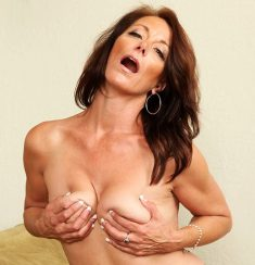 Older woman Mimi Moore peels off ripped jeans