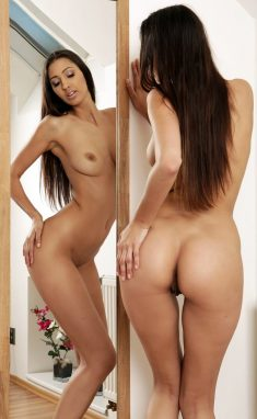 Czech brunette Kitty Jane with shaved pussy in front of a mirror