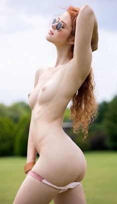 Gorgeous redhead Heidi Romanova naked on a golf course