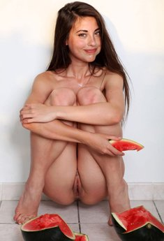 Cute brunette with tiny tits Lorena G crushes a watermelon