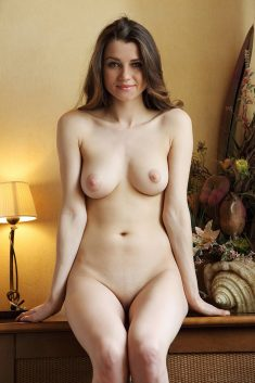Long-haired and eternal beautiful brunette gets naked indoors