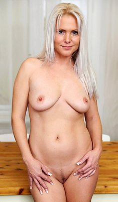 Amazing blonde Kathy Anderson spreading her nice pussy on the table
