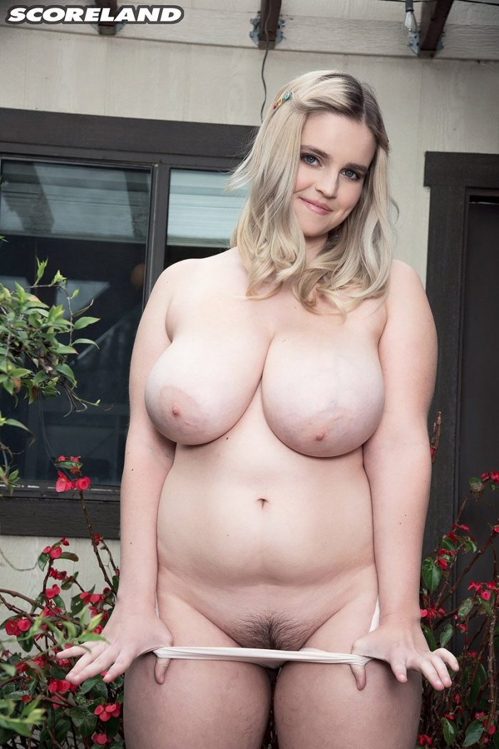 Codi Vore parks her bicycle to expose her big fat tits outside