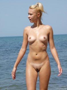 sexy blonde girl by the sea