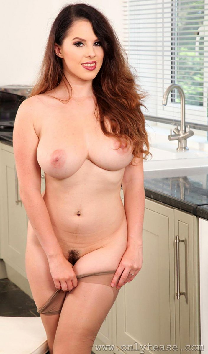 Busty brunette Jo Paul naked in the kitchen