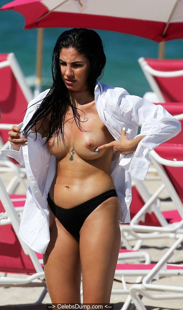 Giulia De Lellis poses topless on a beach