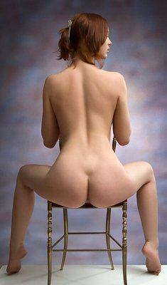 Glamour model with big tits Sylvia in erotic poses on chair