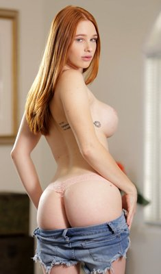 Scarlett Snow is hot redhead with big tits