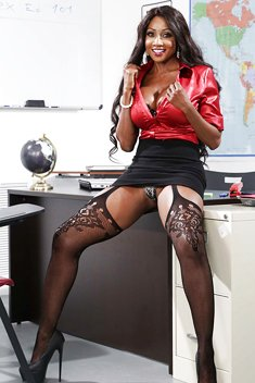 Diamond Jackson removing skirt to pose in sexy stockings