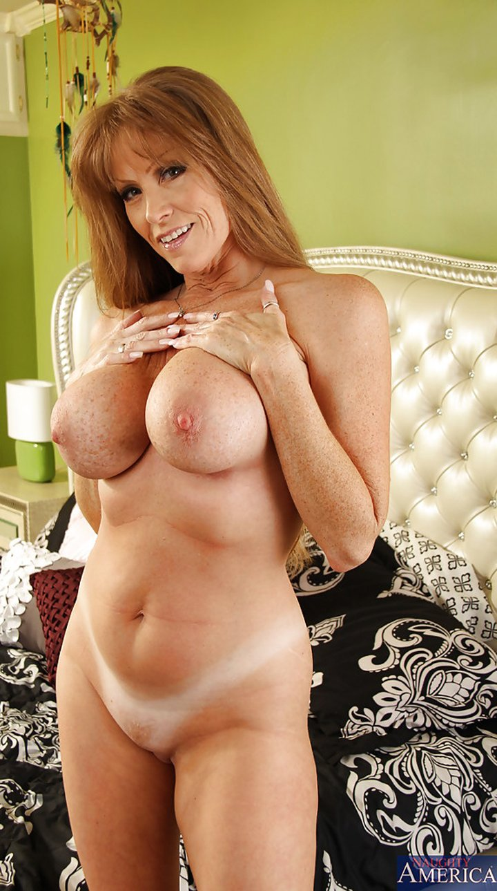 Busty mature Darla Crane with shaved cunt spreading her legs