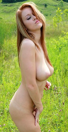 Sexy redhead with big tits Leanna Decker naked on a walk outdoors