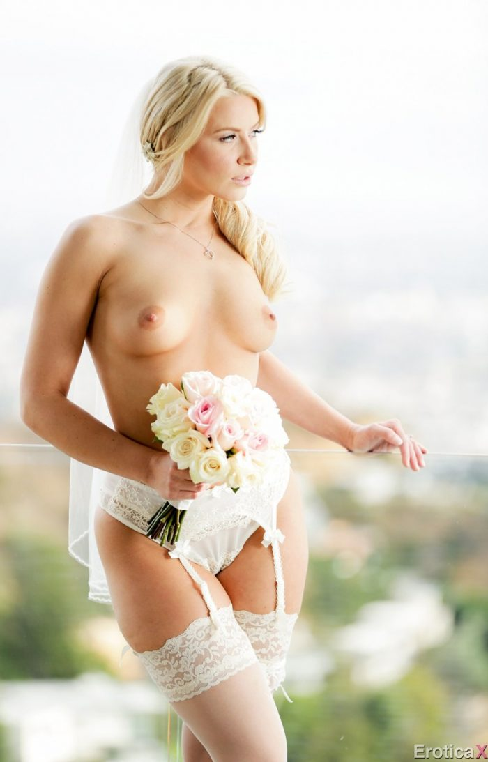 Amazing blonde Anikka Albrite removes her bridal veil and limgerie