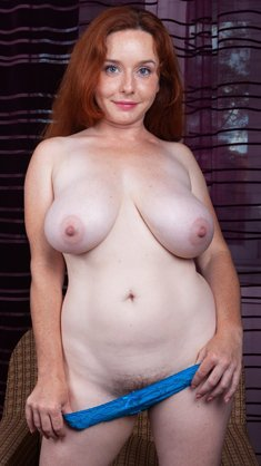 Curvy redhead Elouisa Bush has big natural breasts and quite an inviting hairy bush