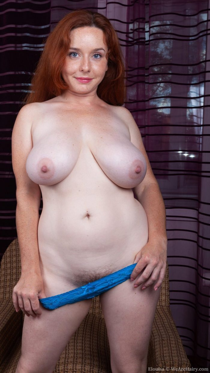 Curvy redhead Elouisa Bush has big natural breasts and quite an inviting hairy bush
