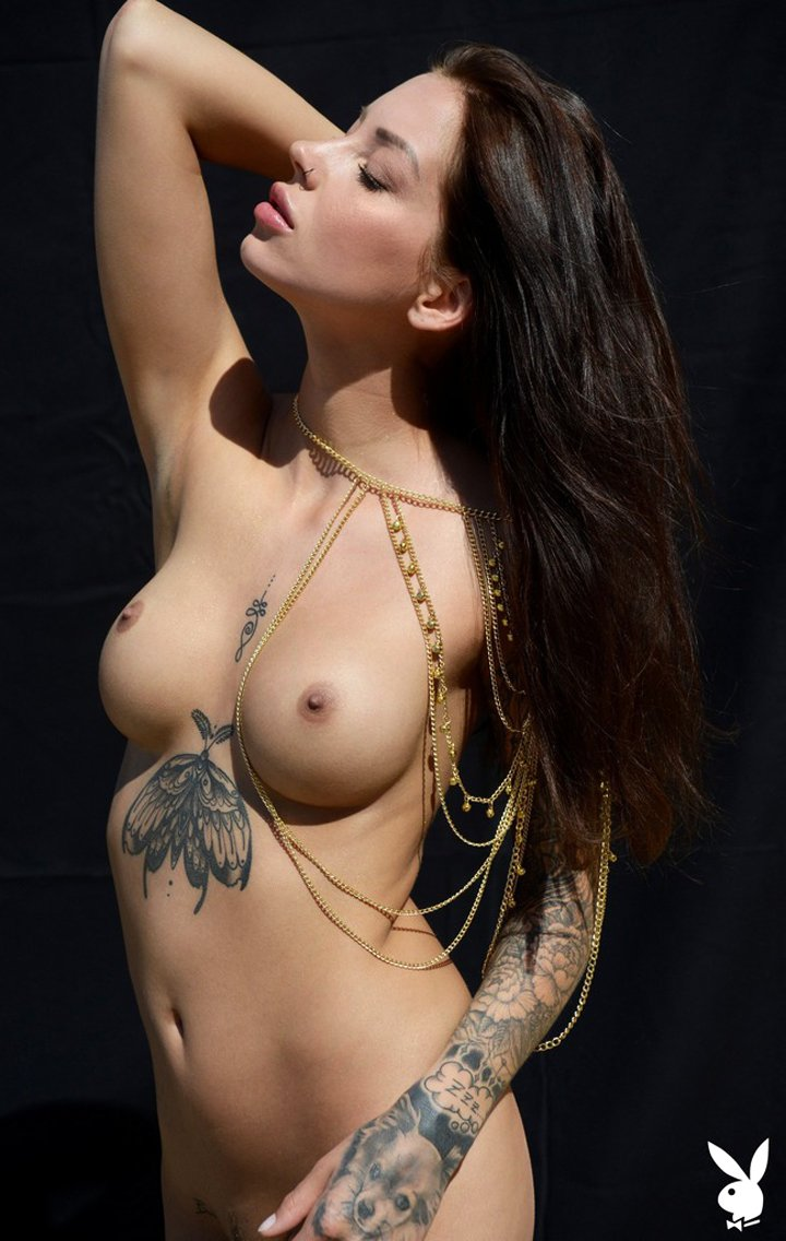 Erotic babe Lena Klahr shows off her tattooed body