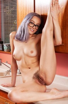 Girl in glasses with dyed hair Ellie Kay spreads her hairy pussy in kitchen