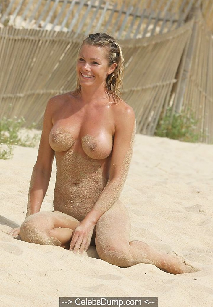 Nell McAndrew topless and nude on a beach in Barbados