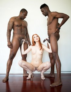 Slim redhead girl Maya Kendrick loves sex with two big black cocks