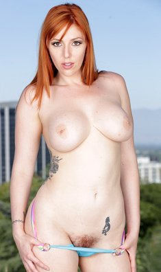 Voluptuous redhead with big tits Lauren Phillips naked outdoors