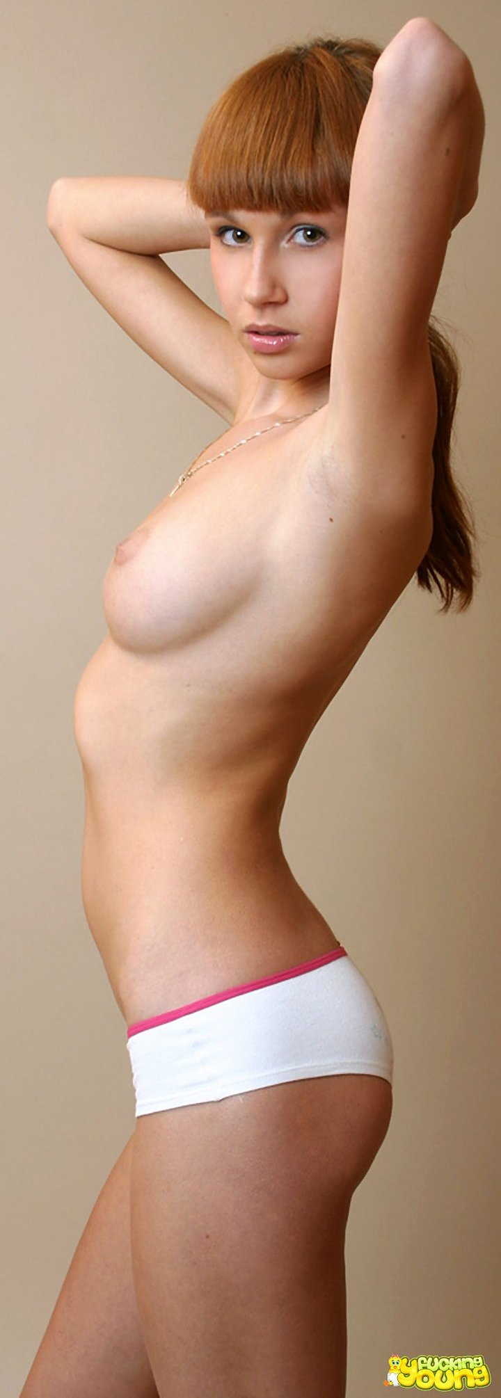 Alluring young redhead shows her hot naked body