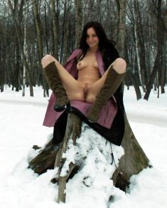 Shameless babe flashing pussy in the snow
