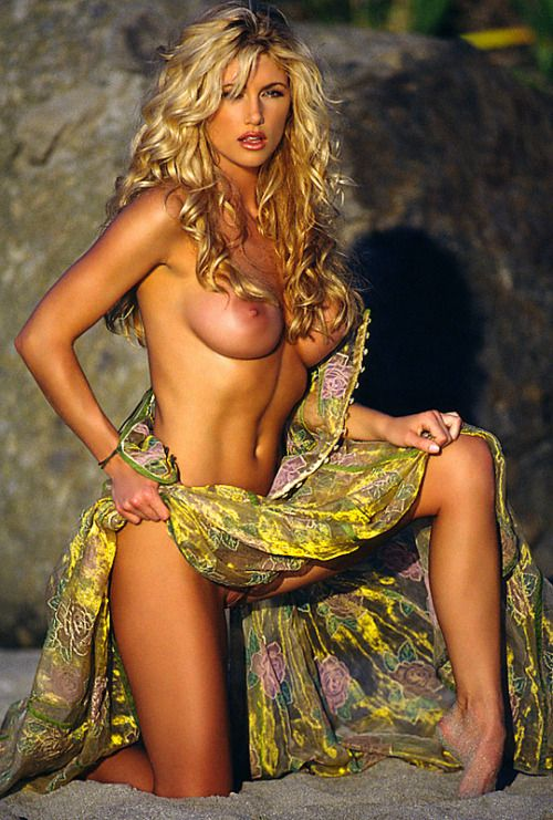 Busty blonde topless