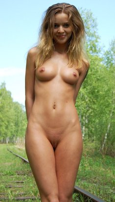 Cute blonde Masha E posing naked on the rails
