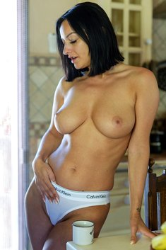 Busty brunette Cassie topless in kitchen