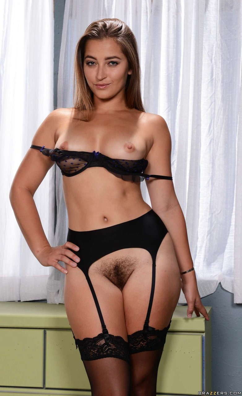 Dani Daniels takes off black lingerie to expose natural tits and hairy pussy