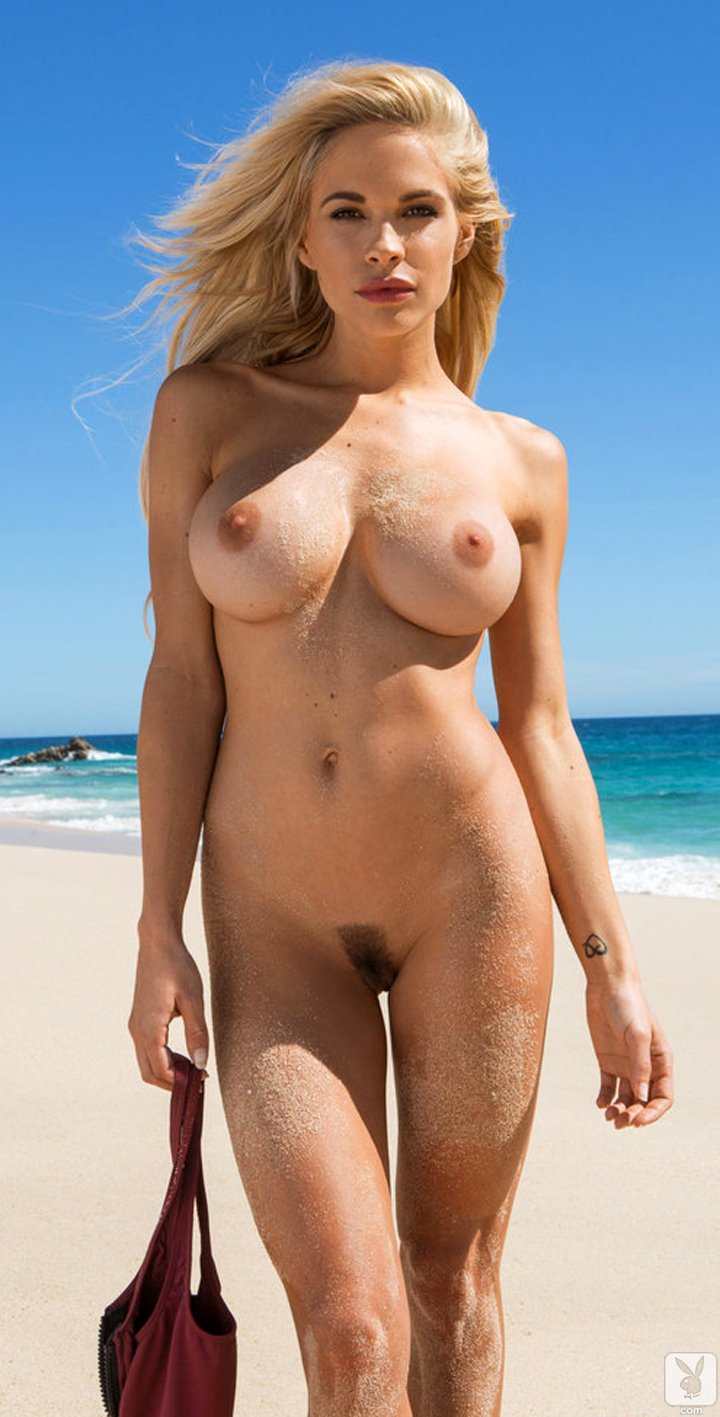 Dani Mathers posing naked on beach