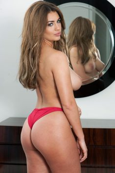 Gorgeous Holly Peers topless in front of the mirror