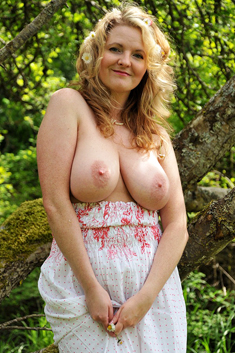 Mature woman Tasty Trixie exposes her big natural tits and shaved pussy