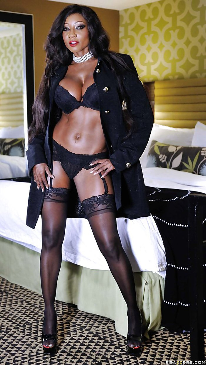 Diamond Jackson in black lingerie under coat
