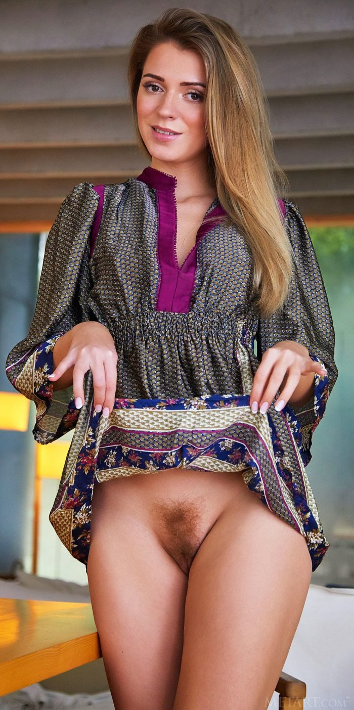 Long haired girl Kalisy shows her hairy pussy