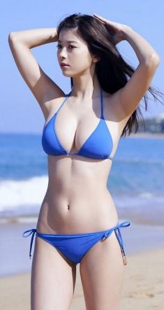 Cute sexy asian girl in bikini outdoors