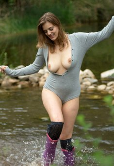 Sexy babe with hot body posing in nature by the river