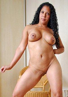 Latina with big boobs posing naked in high heels